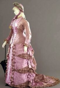 Walking dress, 1878-80, Naples, Italy. via shewhoworshipscarlin Walking dress in two pieces (jacket and skirt) in gros effect violet taffetas, Sartoria Madame Grazini, Naples, 1878-1880 ca.
