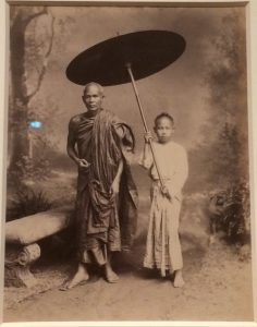 1887 Buddhist with Parasol